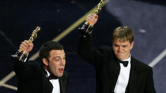 Zwei Männer mit Oscars in der Hand