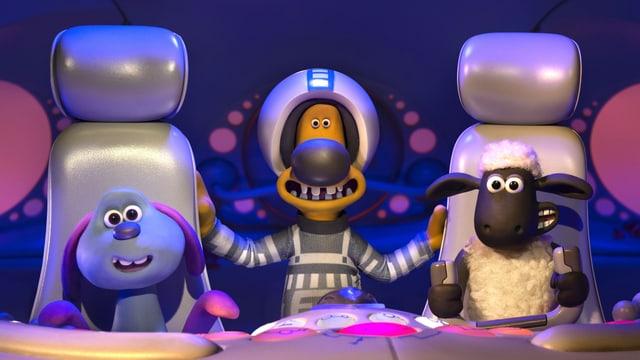Eine violette Knetfigur, ein gelber Hund und ein Schaf im Ufo.