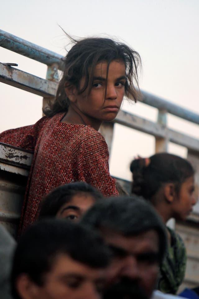 Jesidin afuf der Flucht vor dem IS.