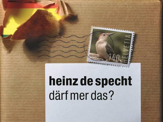 Das neue Cover der Heinz de Specht-CD: eine CD, eingepackt in Päckli-Papier, darunter das alte Logo.