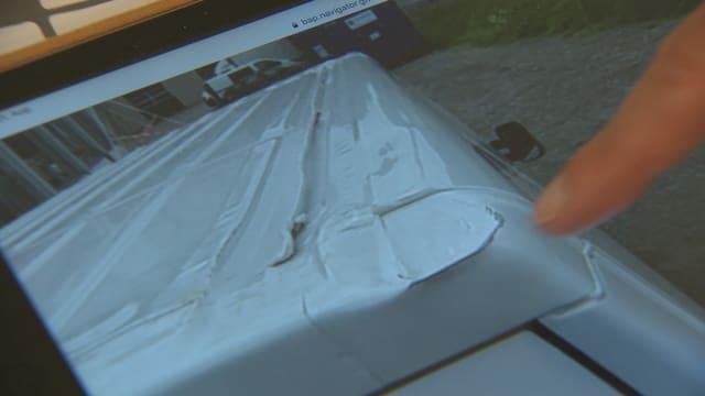 Verbeultes Fahrzeugdach