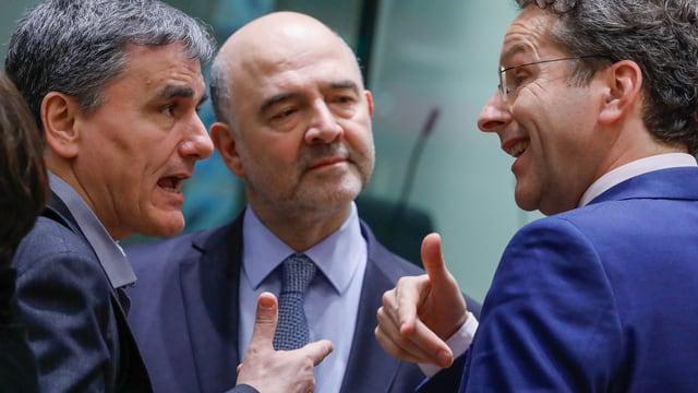 Euclid Tsakalotos (L), Pierre Moscovici und Jeroen Dijsselbloem (20. März).