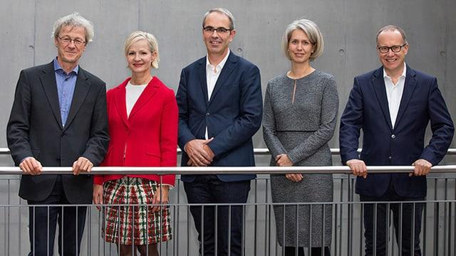 Eine Gruppe von Politikern (Stadtrat der Stadt Luzern): Drei Männer und eine Frau.