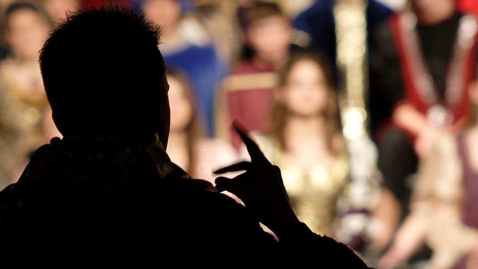 Dirigent und Chor (Symbolbild).