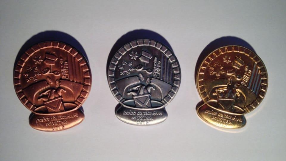 Las medaglias da tschaiver che l'artist Antonio Di Bella ha creà.