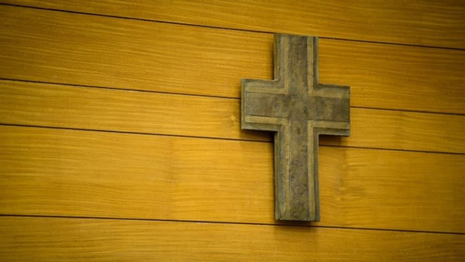 Er la crusch vegn sut squitsch sco simbol religius.