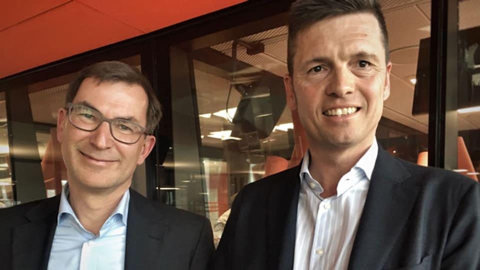 Martin Rohner, CEO der Alternativen Bank Schweiz (links) und Christian Leitz, Chef Nachhaltigkeit bei der UBS.