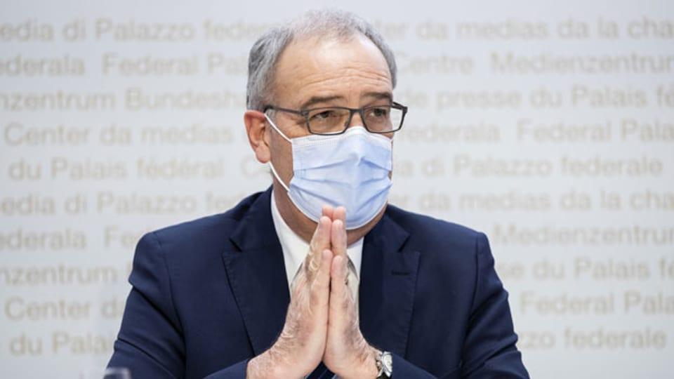 Bundespräsident Guy Parmelin an der Medienkonferenz des Bundesrates zur aktuellen Lage im Zusammenhang mit dem Coronavirus, am 24. Februar 2021 in Bern.