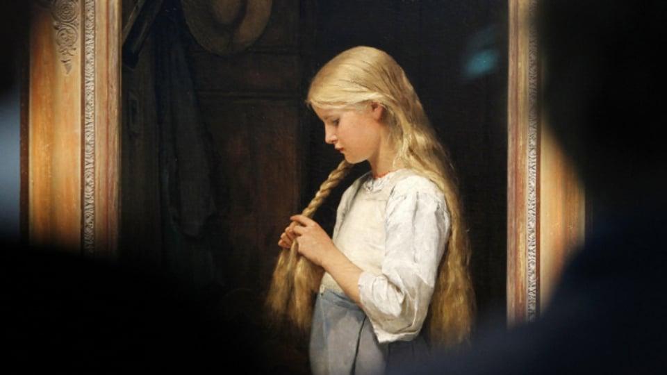 «Mädchen die Haare flechtend» heisst dieses Bild von Albert Anker.
