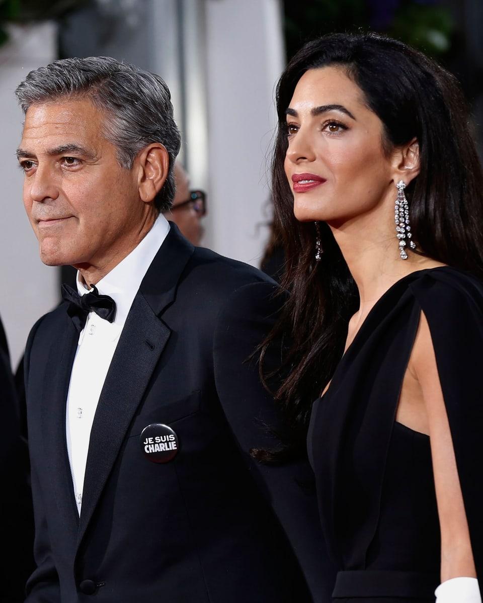 George und Amal Clooney posieren für die Fotografen