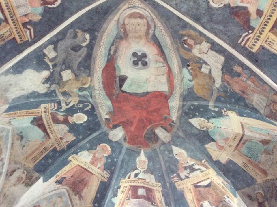 Il Cristus cun las trais fatschas diffusas che simboliseschan la trinitad.