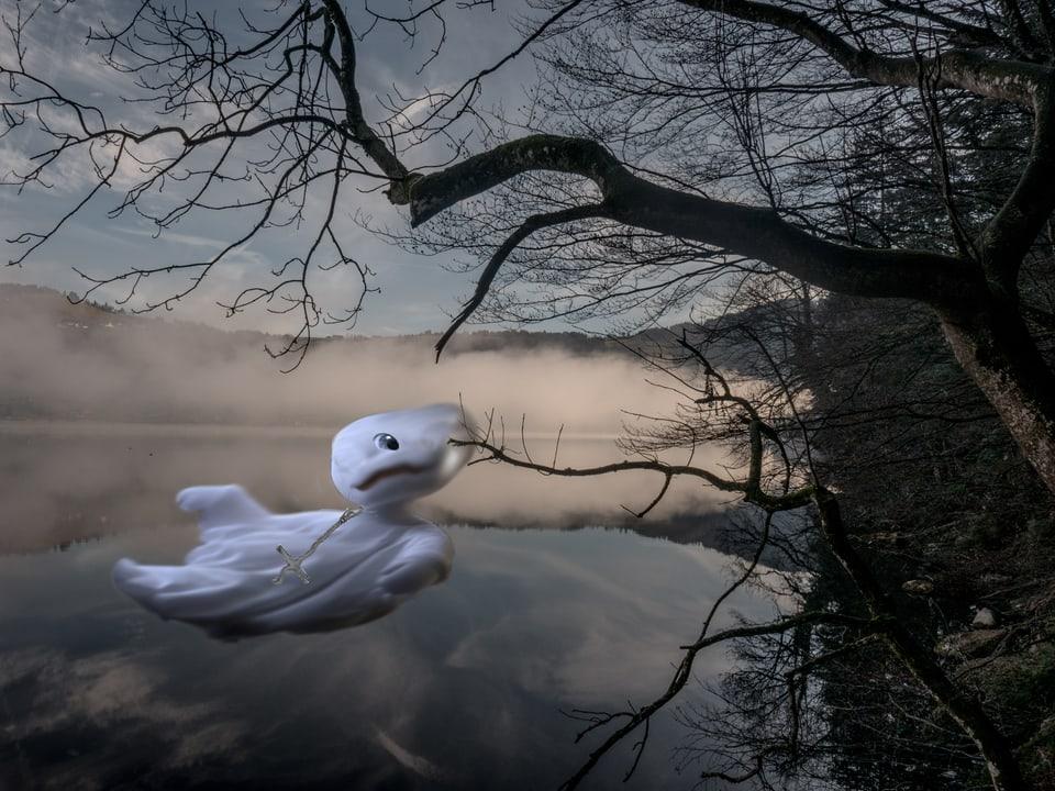 Totemügerli in Weiss an einem See (Bildmontage).