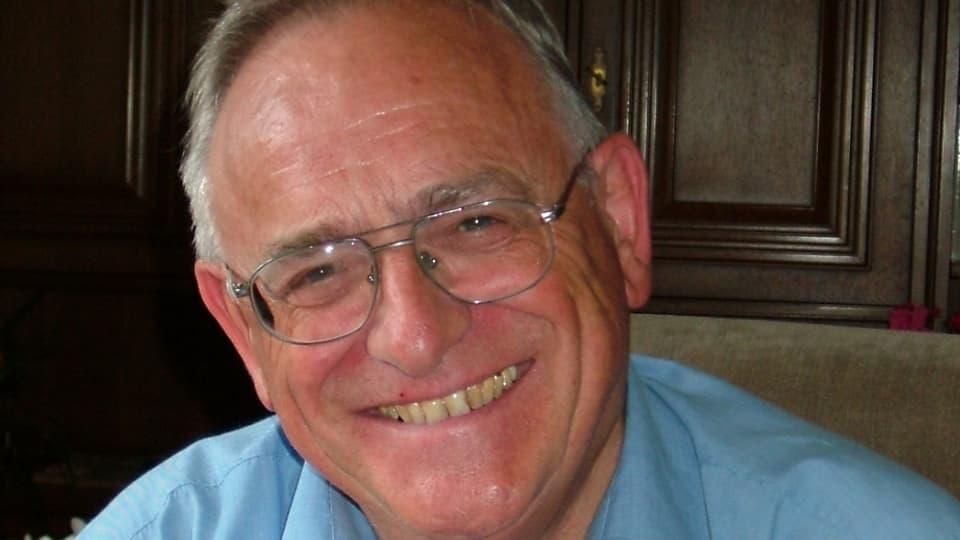 Purtret dad Arnold Spescha.