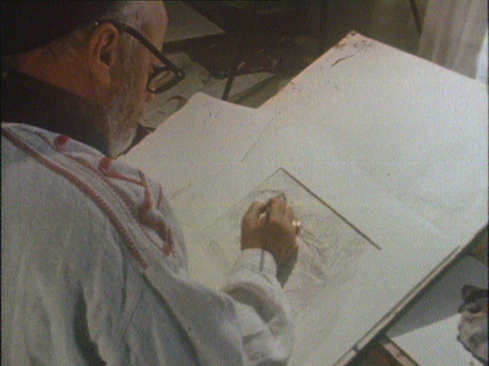 Aluis Carigiet dissegna en ses atelier a Trun / Flutginas.