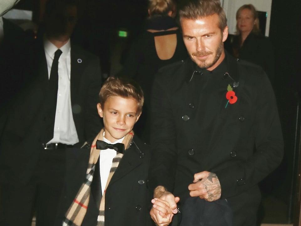 David Beckham mit Sohn Romeo an der Hand.