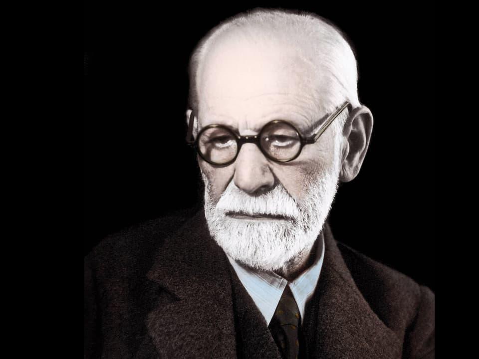 Mann mit Glatze, weissem Bart und runder Brille