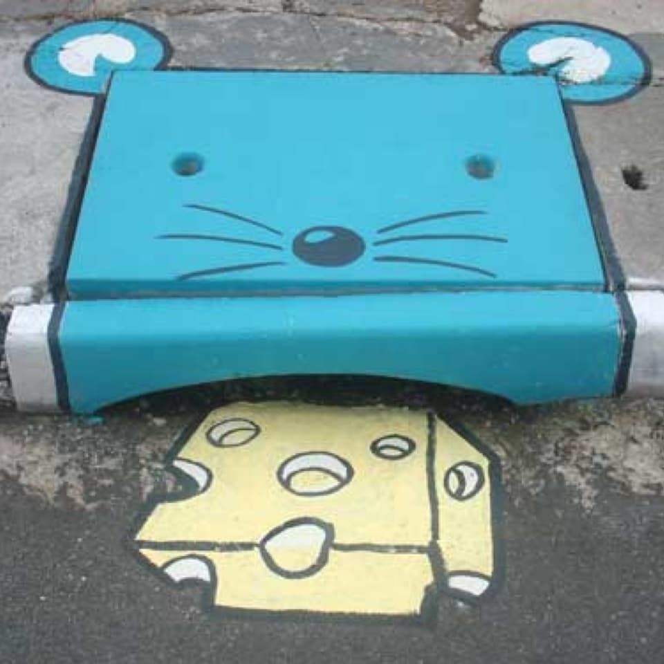 Eine Maus die Käse frisst: So wurde ein Deckel gestaltet.