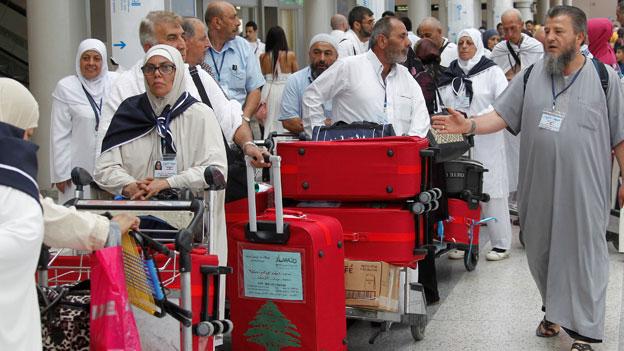 Pilger am Flughafen in Beirut, Libanon.