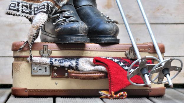 Koffer mit Winterkleidern.