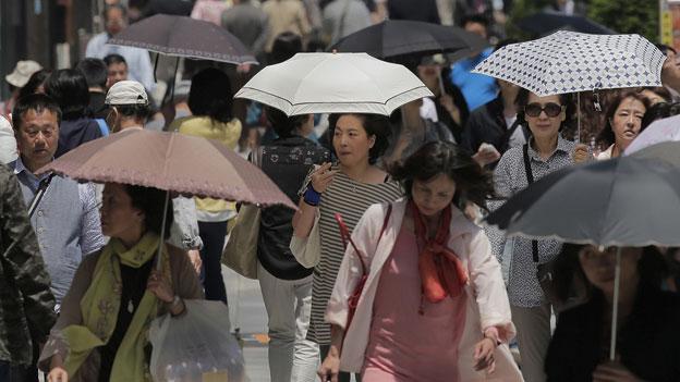 Japans Erfolgsrezept - und die Kehrseite für die Bevölkerung