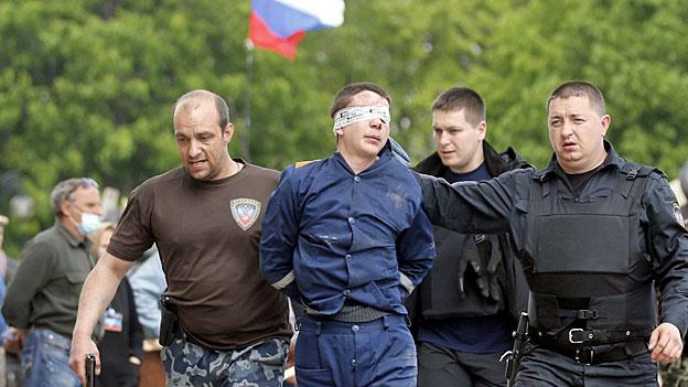 Pro-russische Separatisten halten an Referendum fest