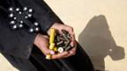 Koptischer Christ mit Munitionshülsen.