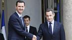Syriens Präsident al-Assad (l) wird von Sarkozy in Paris mit allen Ehren empfangen.