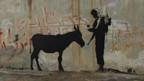 Banksys Kunst auf der Mauer.