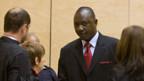 Thomas Lubanga (Mitte) vor Gericht in Den Haag.