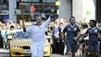 Quer durch London: die Olympische Flamme