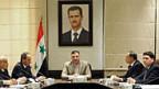 Premier Riad Hijab, in der Mitte unter Assads Portrait, hat sich abgesetzt
