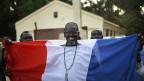 Ein Bewohner der nördlich von Bamako gelegenen Ortschaft Niono zeigt seine Freude über die französische Unterstützung gegen die Islamisten.