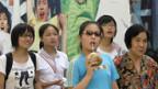 Menschen geniessen die Olympischen Spiele in Peking.