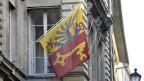 Ein halber Adler auf gelbem Grund und ein Schlüssel auf rotem Grund: Das ist das Genfer Wappen.
