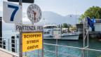 Ein Plakat deutet auf den Streik des Schiffspersonals hin.