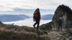 Wanderer unterwegs in den Bergen