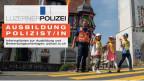 Polizist geht mit Kindern über einen Zebrastreifen.