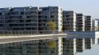 Neue Wohnungen sollen günstig vermietet werden müssen - wenn die Eigentümer von einer Umzonung profitiert haben.