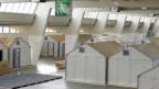 Ikeahäuschen für Flüchtlinge aufgestellt in einer Halle