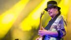 Carlos Santana en l'element cun sia ghitarra l'onn 201