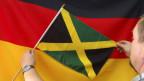 Las bandieras da la Germania e da la Giamaica