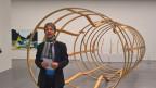 Il co-directur dal Museum d'art dal Grischun Stephan Kunz en l'exposiziun annuala da las artistas e dals artists grischuns.