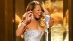 Mariah Carey durant in concert