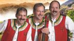 ina fotografia dals Zellberg Buam en costum austriac