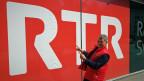 ina foto da Semino Rossi, davant il logo dad RTR