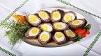 Besonders Männer mögen die weichgekochten Eier, die von einem Rindsplätzli umhüllt sind.