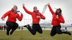 Eishockey-Frauen springen mit Bronzemedaille hoch.