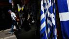 Ein Mann geht an einem Stand mit griechischen Flaggen vorbei.