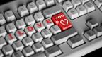 Tastatur mit einer Herz-Taste.