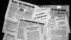 Aufgeschlagene Zeitungen von 1918
